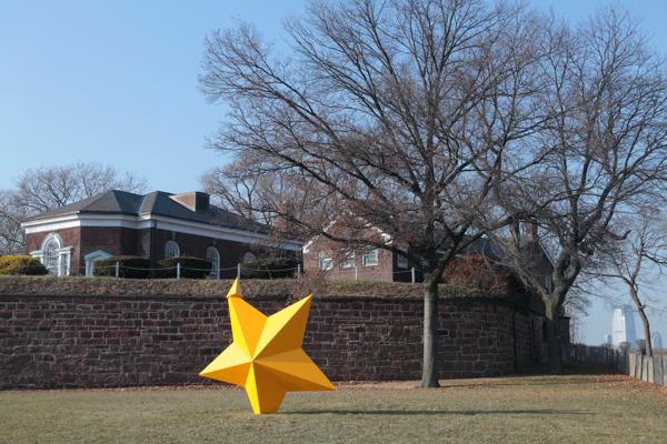 Mark Handforth, Saffron Star, 2013, Painted aluminum, 330.2 x 317.5 x 127 cm, Installation view 'Sidewalk Island', Governor's Island, New York, 2014