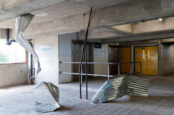 Seven Split Overglide, 2012, Bamboo, paving slabs, acrylic paint, masonry paint, corrugated metal, clothes racks, woven bags, cable ties, linen thread, Dimensions variable