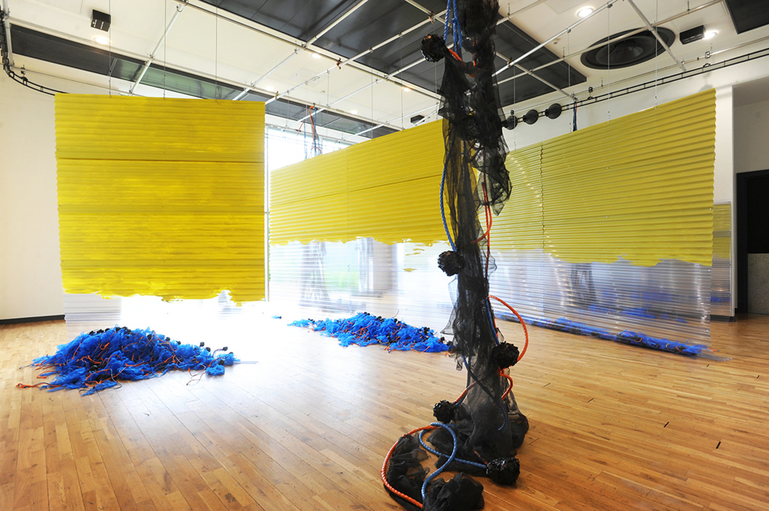 Cross Block Split, 2014, Corrugated PVC sheeting, rope, electrical tape, paint and debris netting, 10 x 10 meters