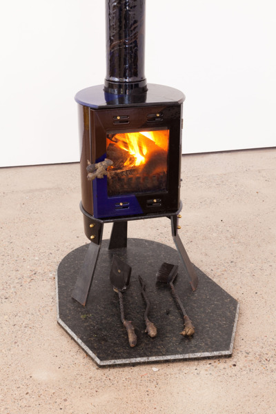 Firelit, 2013, Enamelled cast iron stove, steel legs, cast bronze, 81 x 57 x 47 cm, stone hearth 3 x 73 x 94 cm, Ginger Threesome, 2013, Wrought iron, cast bronze, Shovel 11 x 21 x 52 cm, poker 8 x 4 x 45 cm, brush 25 x 4 x 51 cm