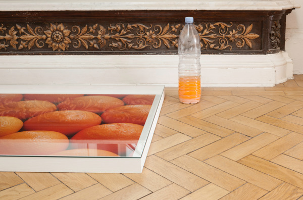 Hayley Tompkins, Digital Light Pool (Orange), 2013 (detail), Acrylic on plastic trays, stock photographs, wooden boxes, glass, plastic bottles, watercolour, Dimensions variable, Installation view, 'Scotland + Venice 2013', Common Guild, Glasgow, 2014