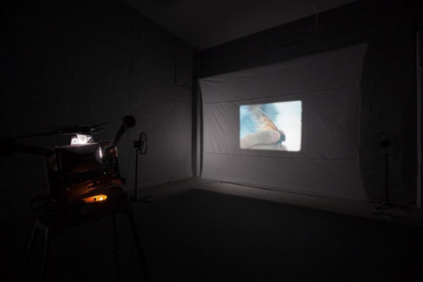Luke Fowler, Composition for Flutter Screen (w. Toshiya Tsunoda), 2008, Installation with 16mm colour film and projector, homemade screen, timer, wire, fans, lights, Edition of 3 + 2 AP