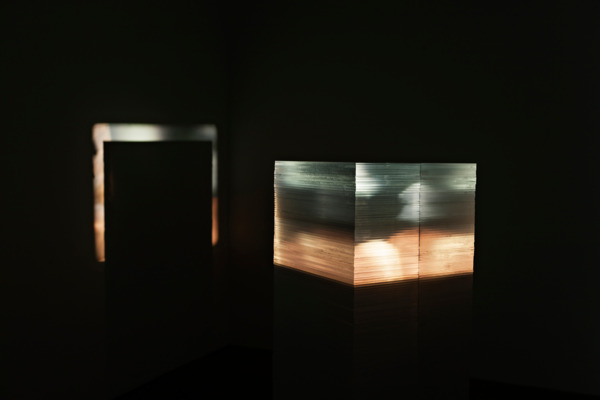 Luke Fowler & Toshiya Tsunoda , LEADER AS GUTTER,  2013, 130 acrylic sheets (50 x 50 x 0.8 cm each), 16mm film, 2 speakers, CD player, amplifier, Dimensions variable, Edition of 3 + 1 AP