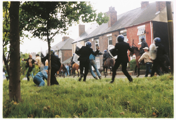 The Battle of Orgreave, 2001. Police officers pursuing miners through the village.