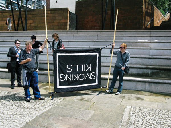 Procession, 2009. 'Smoking Kills' banner.