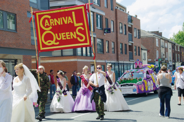 Procession, 2009. Carnival queens with decorated cars.