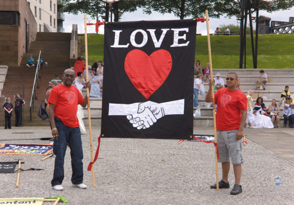 Procession, 2009. '16 Aug 1819, Love' banner.