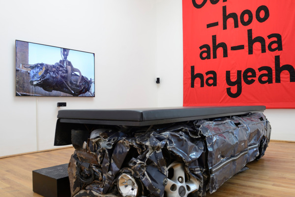 Jeremy Deller, English Magic, 2013, Film installation including a banner made by Ed Hall, a bench and a HD digital video, Banner: 335 x 292 cm, film duration: 14 min 23 sec, Bench: 130 x 298 x 78 cm , Installed dimensions variable, Edition of 3 + 2 AP