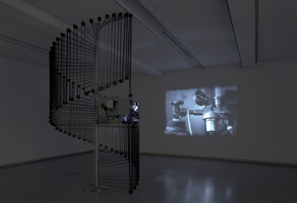 Simon Starling, Wilhelm Noack OHG, 2006, Stainless steel, film projector, 35mm film looped, light, sound, 407 x 192 cm