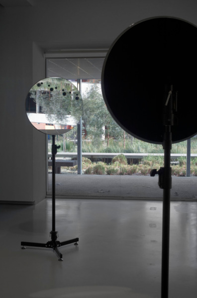 Simon Starling, Venus Mirrors (05/06/12, Hawaii & Tahiti (Inverted)), 2012, 2 drilled 600mm telescope mirrors, stands, 179.7 x 66 x 56 cm each (60 cm diameter each), Edition of 5 + 1 AP