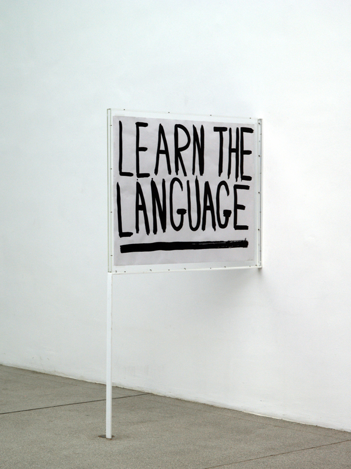 Learn The Language, 2003, Ink on reverse of Felix-Gonzales Torres poster, perspex, steel, 116 x 79 x 4.6 cm