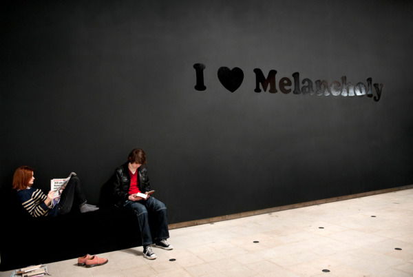 I ♥ Melancholy, 1993, Gloss black paint on matte black painted wall, with participant, Dimensions variable, Installation view, 'Joy In People', Hayward Gallery, London, 2012