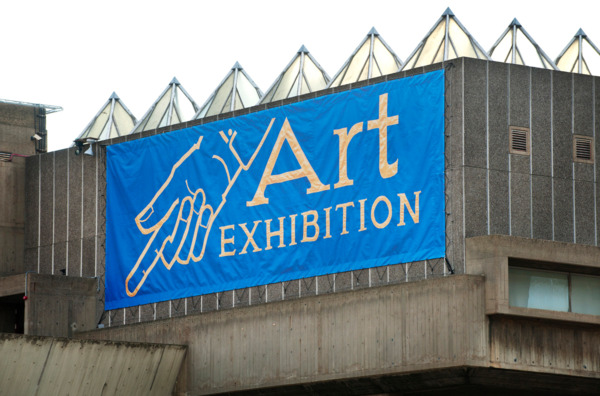 'Art Exhibition' banner designed by Ed Hall, 2012, Vinyl mesh banner on wire tension frame, Exterior view, 'Joy In People', Hayward Gallery, London, 2012