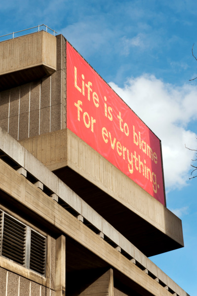 'Life is to Blame for Everything' banner designed by Ed Hall, 2012, Vinyl mesh banner on wire tension frame, Exterior view, 'Joy In People', Hayward Gallery, London, 2012