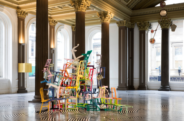 Jim Lambie, Seven and Seven Is or Sunshine Bathed the Golden Glow, 2008, Wooden chairs, handbags, mirror, gloss paint, 216 x 350 x 270 cm, Installation view 'Forever Changes', Gallery of Modern Art, Glasgow, 2008