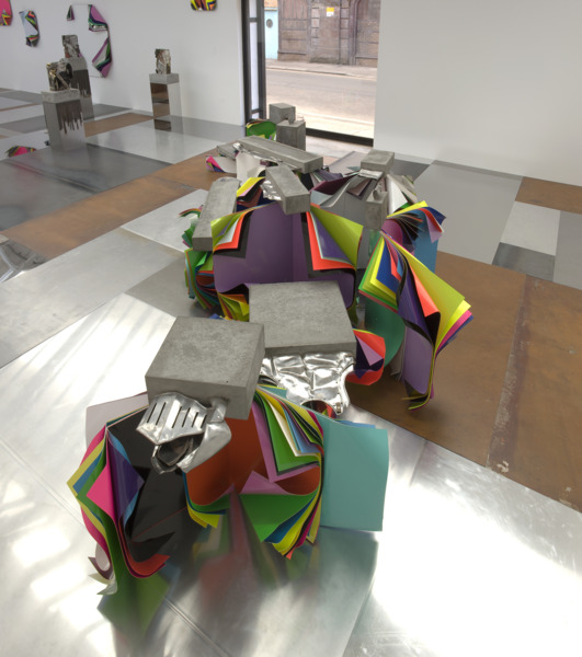 Jim Lambie, Metal Urbain 2010, Aluminium sheets, gloss paint, fluorescent paint, flattened suit of armour set in concrete blocks, 360 x 160 x 90 cm