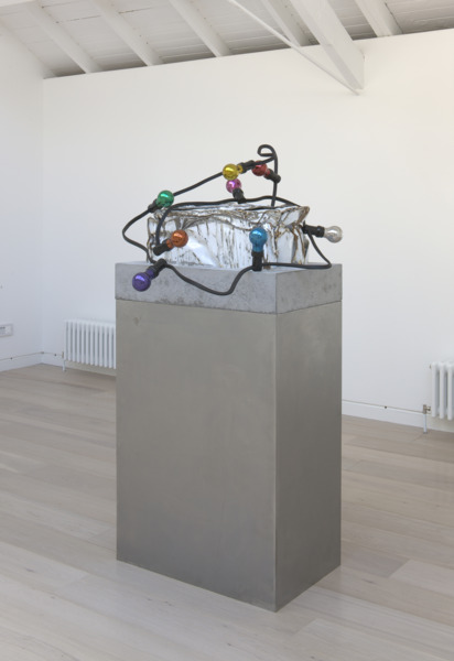 Jim Lambie, Sunset, 2010, Crushed washing machine, stainless steel lightbulbs, steel fabricated festoon lighting set in concrete block, steel plinth, 152 x 186 x 81 cm