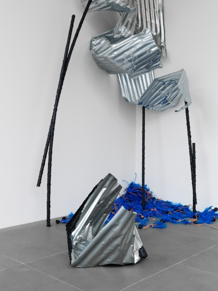 Low-Grade Oscillator, 2013, Corrugated iron, scaffolding net, seagrass rope, electrical tape, plastic pipe, nylon, plastic bags, Dimensions variable