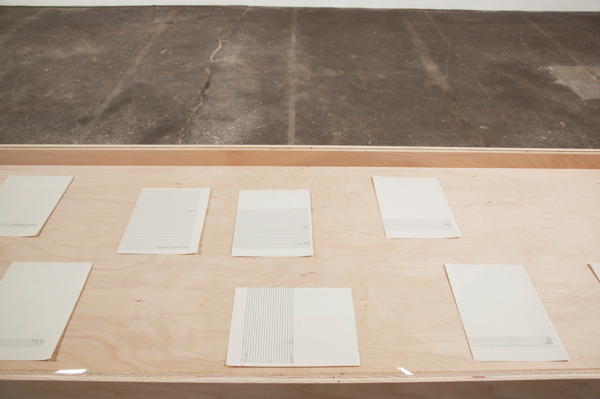 Smallland, 2012, Typewritten text on newsprint paper, plywood, plexiglass, 11 parts: 21 x 14.8 cm each, Vitrine: 79 x 203 x 61 cm