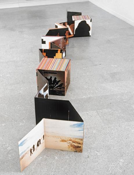 Stakka, 1999, Album covers, tape, blank record sleeves, acrylic paint, 31 x 348 x 89 cm