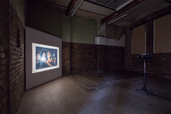 Anne Collier, Women With Cameras (Self Portrait), 2017, 35mm slides, 35mm slide projector, pedestal stand, and base, Dimensions variable, Edition of 3., Installation view, The Modern Institute, Bricks Space, Aird's Lane, Glasgow, 2017