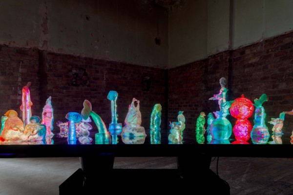 To Disturb Somnolent Birds, 2020, Perspex table, 19 resin and pigment sculpture with LED strip, WiFi controller, electronic components, Jesmonite buckets with speakers, looped soundtrack, wooden bench, Overall dimensions: 120 x 240 x 93 cm
