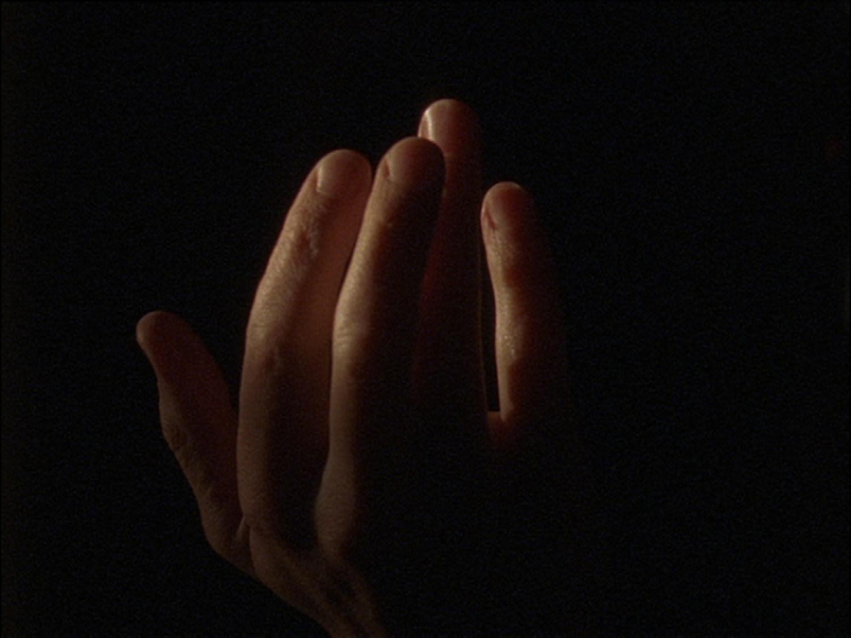 Film still from All Divided Selves, 2011