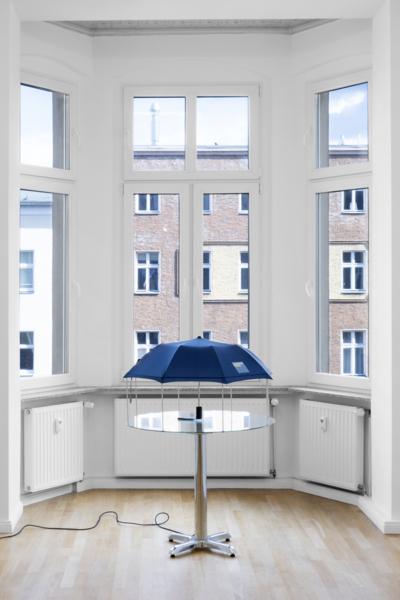 Umbrella Dryer (Goldman Sachs), 2017/2019, Umbrella, aluminum tubing, glass, motorized turntable, chrome table base, 127 x 91.5 x 91.5 cm, 50 x 36 x 36 in, Installation view, Sweetwater, Berlin, 2019